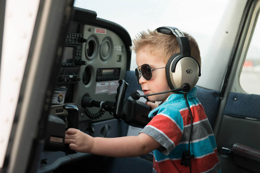 Jace flying a plane at the Regina Flying Club - Top Gun Favel Family 2015