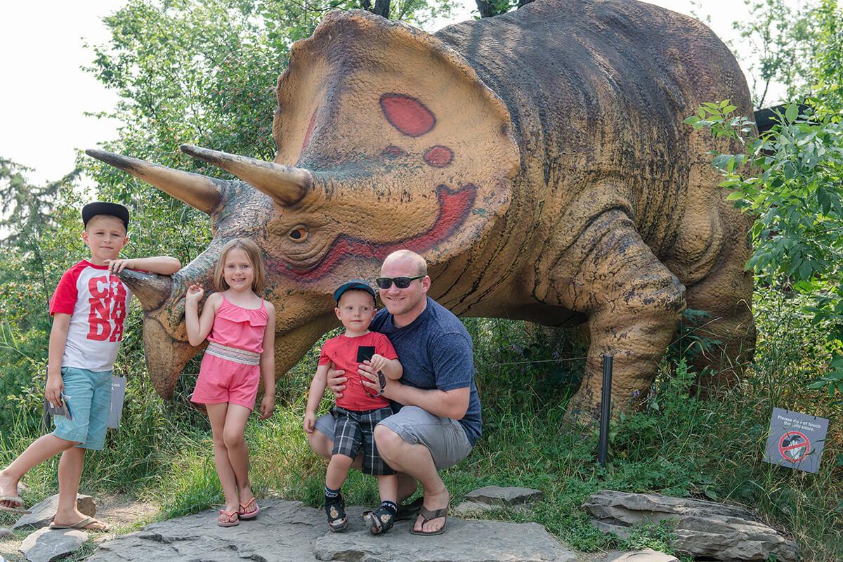 Exploring dinosaur park at the zoo