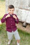 Little boy adjusting his bowtie