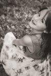 Little girl twirling in the garden