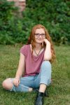 Pre-teen girl with curly red hair