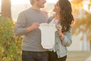 Couple announces pregnancy with onesie