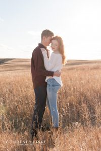 Couple in the field at Wascana Trails