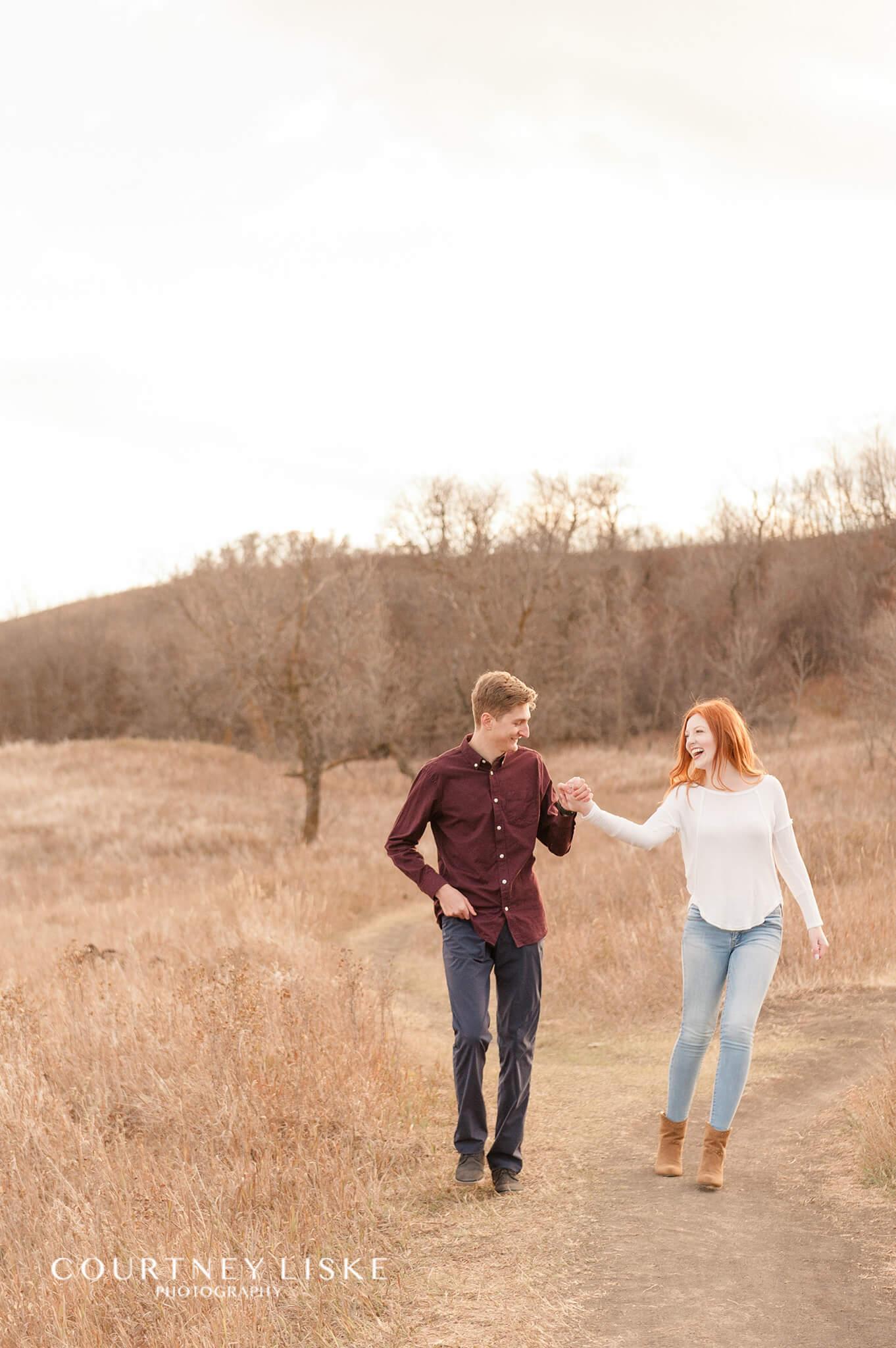 Couple walking along a path at Wascana Trails