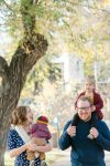 Family of four walking through Wascana Park Regina