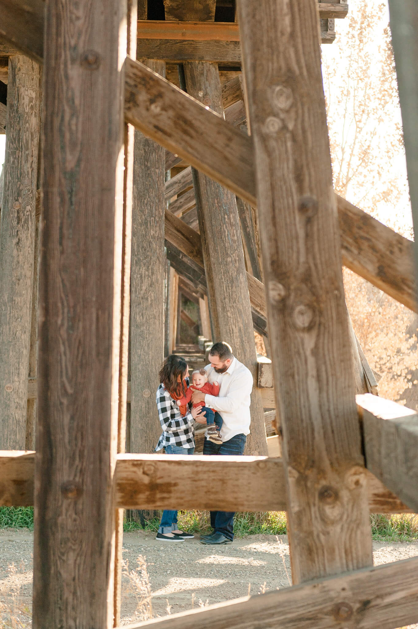 Korchinski family under wooden bridge near White City Saskatchewan