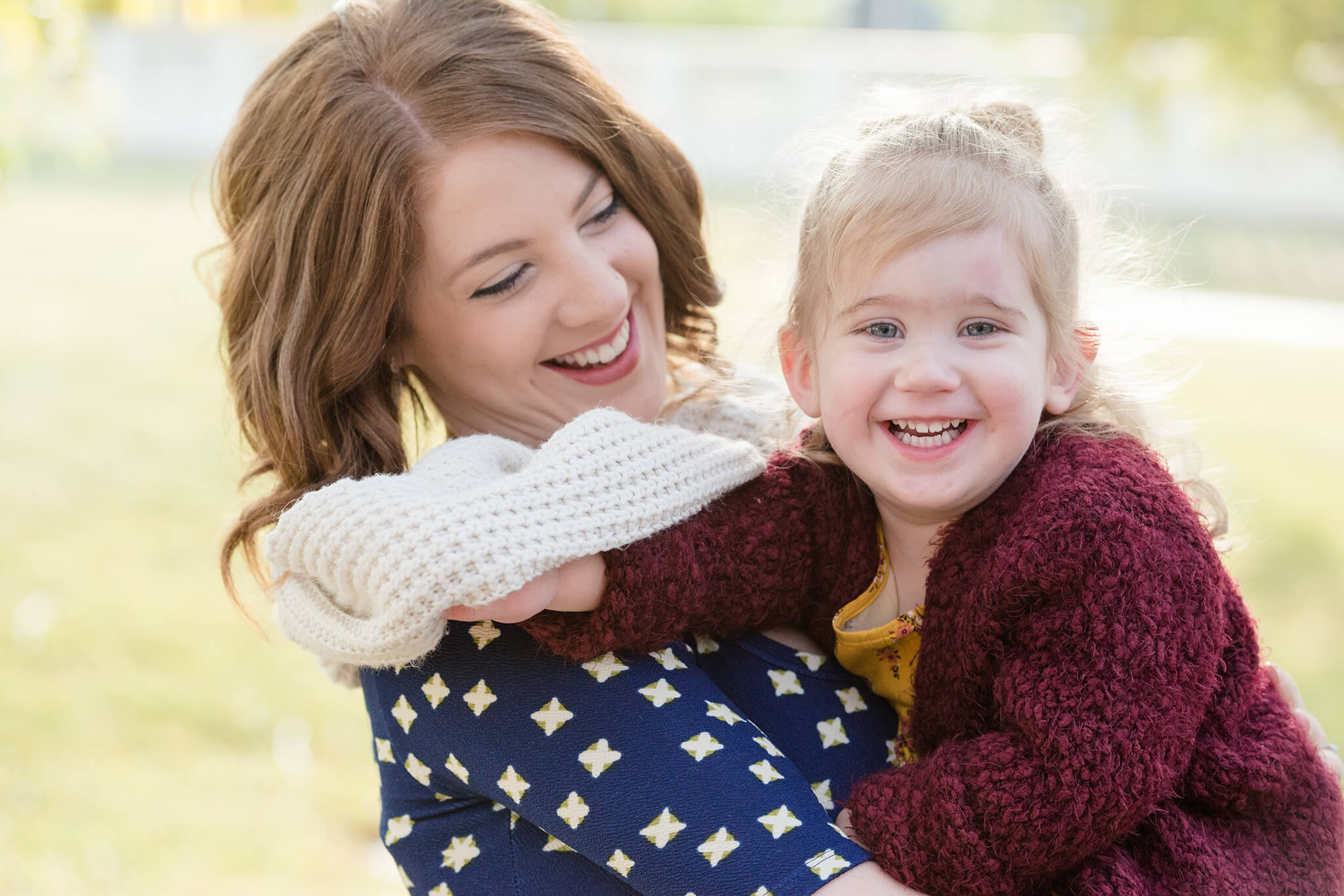 Little girl in a red sweater with her mom in Regina