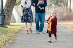 Little girl marches ahead of her family in Wascana Park