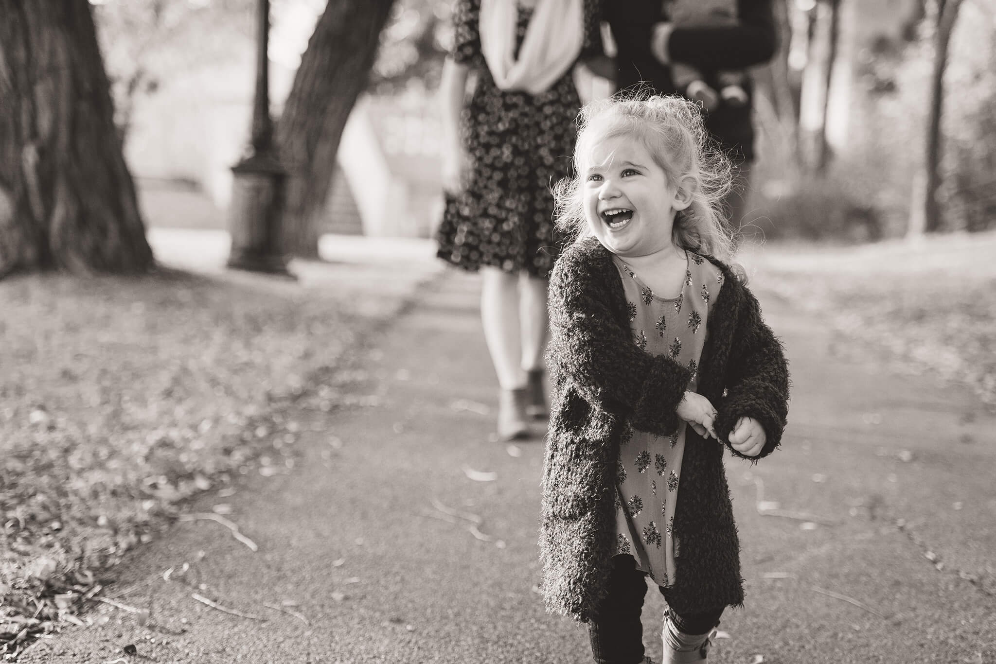 Little girl smiling in large sweater