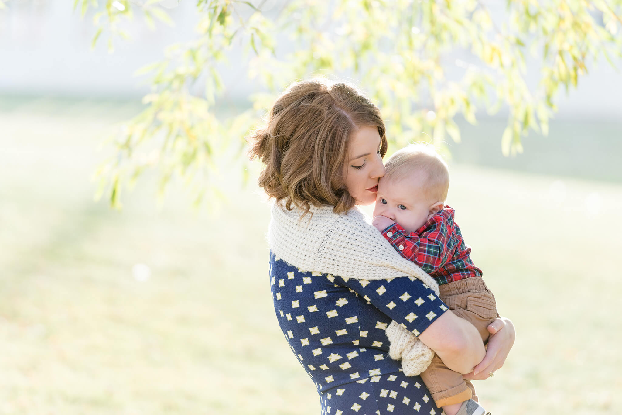 Mom with her baby boy underneath a willow tree in Wascana Park