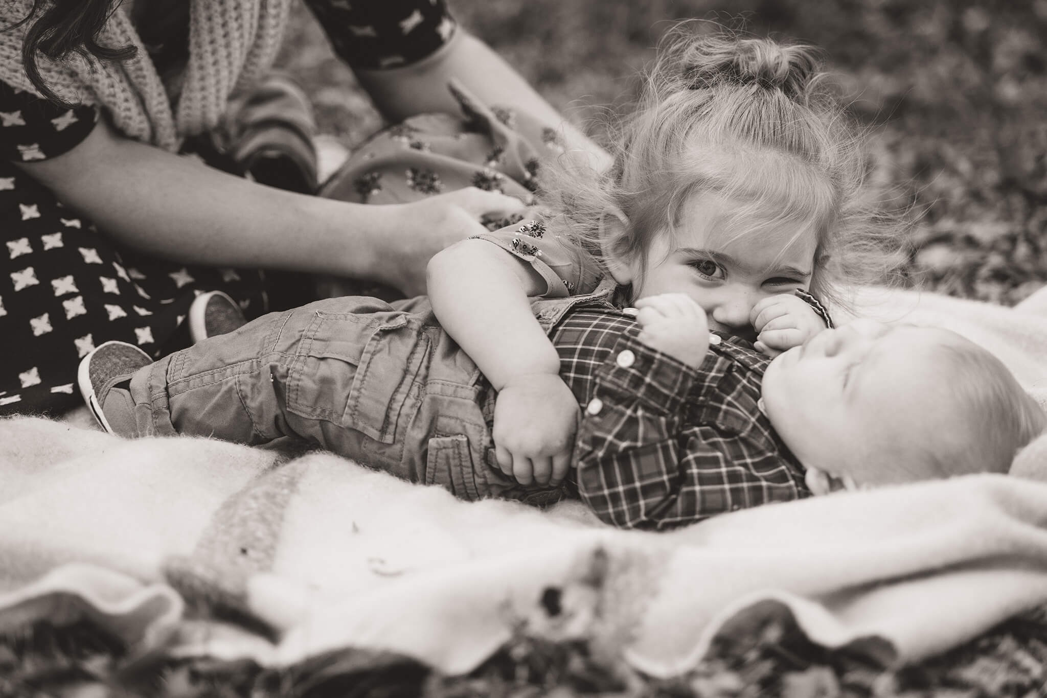Sister giving baby brother big hugs