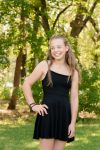 Tween girl in black dress in Regina Wascana Park