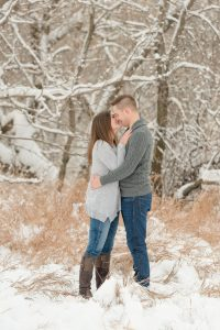 Couple go in for an intimate kiss in the snow
