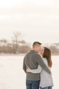 Man and woman are standing together in snowy Lumsden Valley