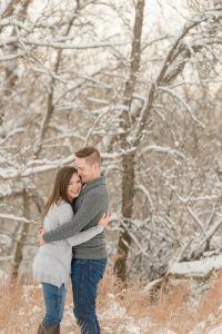 Woman laughs as her fiancee embraces her