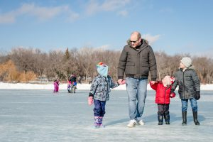 Family walking on the ice at Waskimo Winter Festival