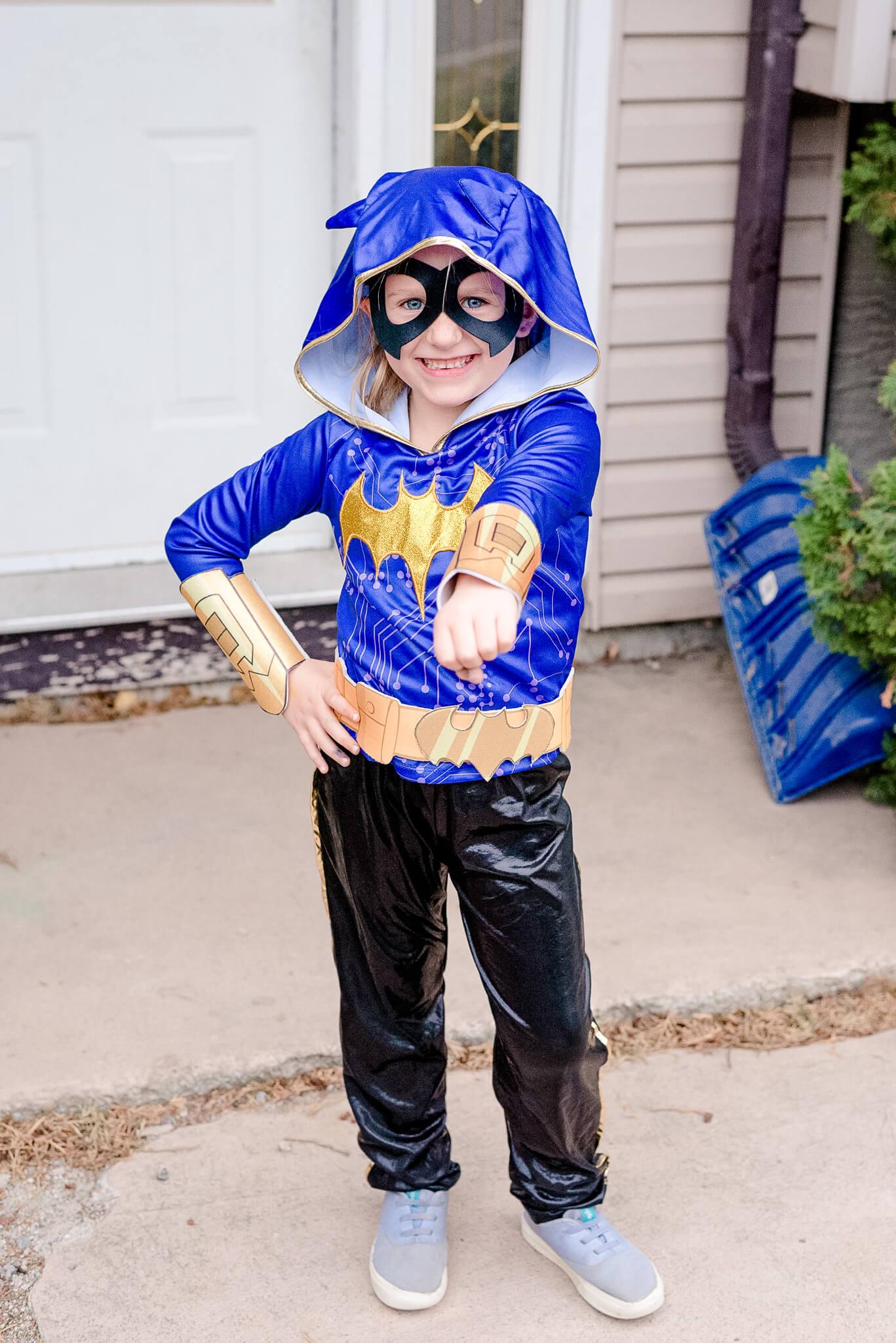 Girl dressed as Batgirl for Halloween