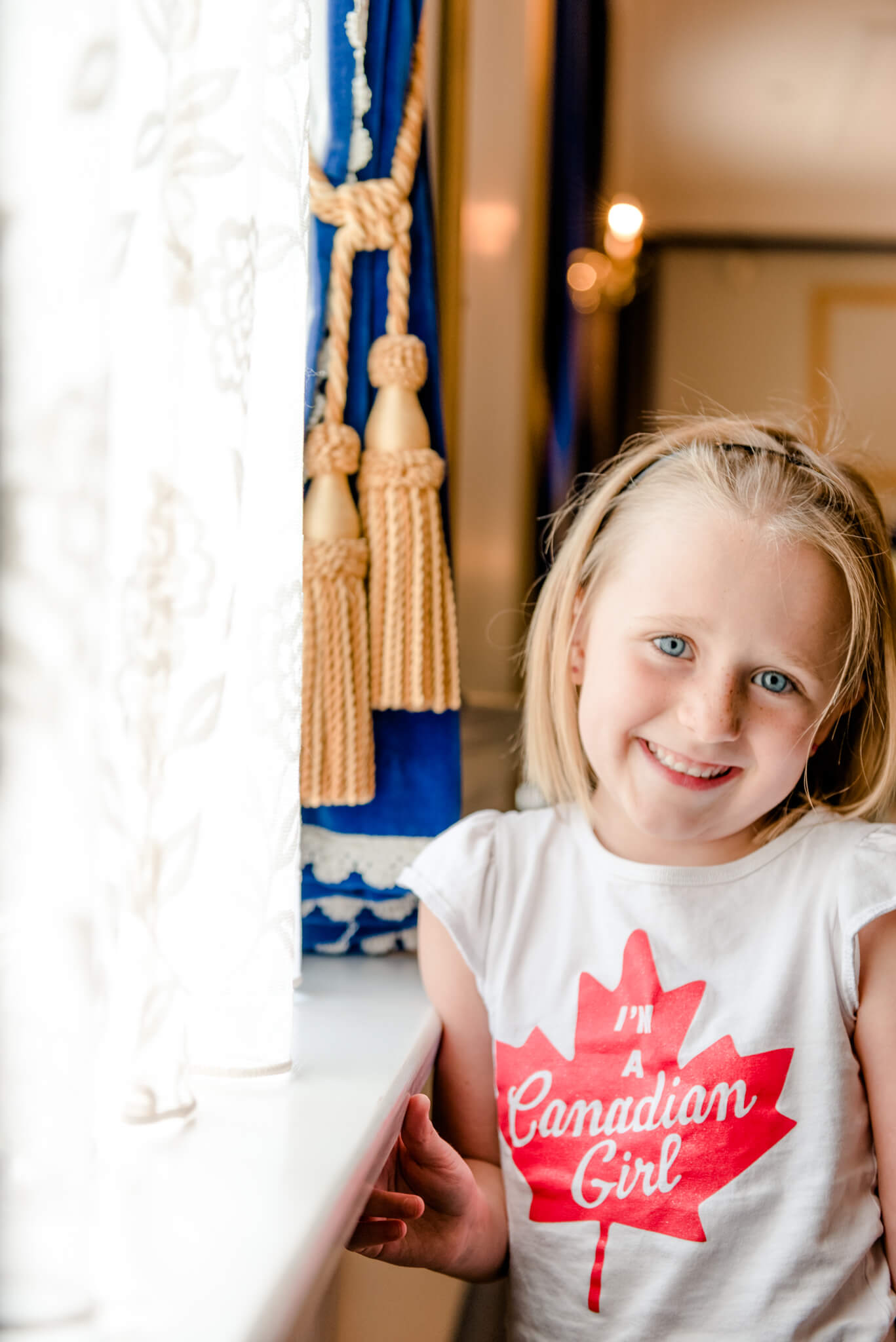 Little girl at the window at Government House