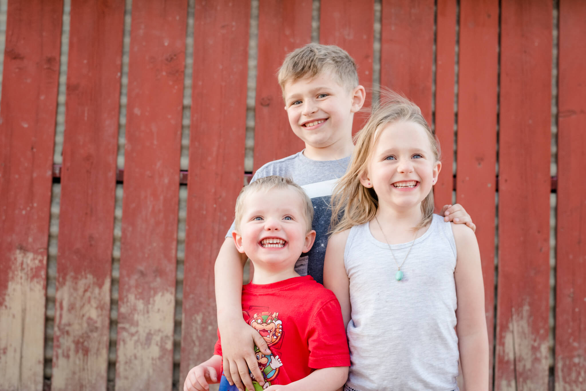 Two boys and a girl standing alley
