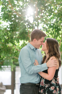 Couple in between trees at their Regina engagement session