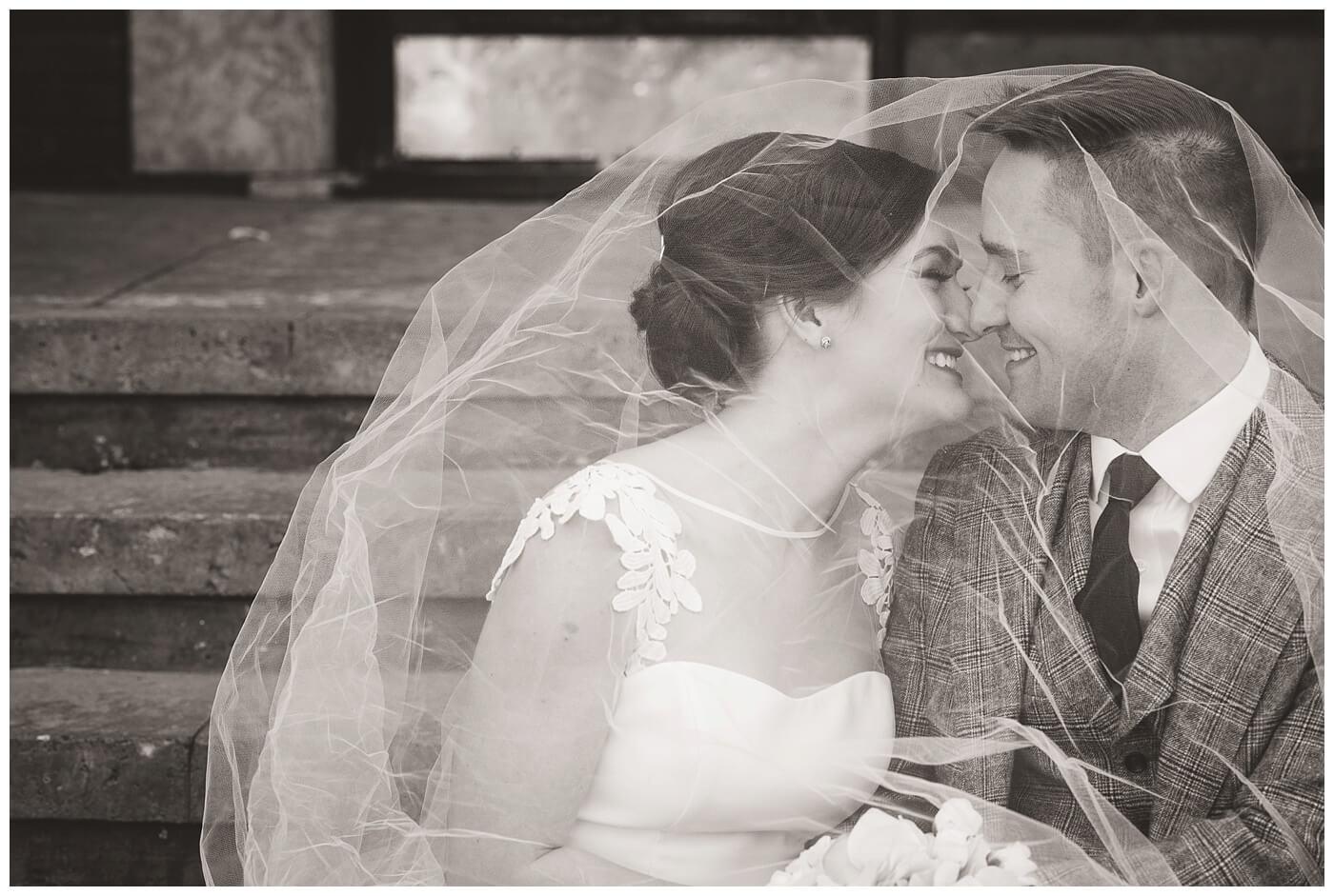 Mark & Kyra - Wedding - 20 - Kiss outside of Crave Kitchen + Wine Bar