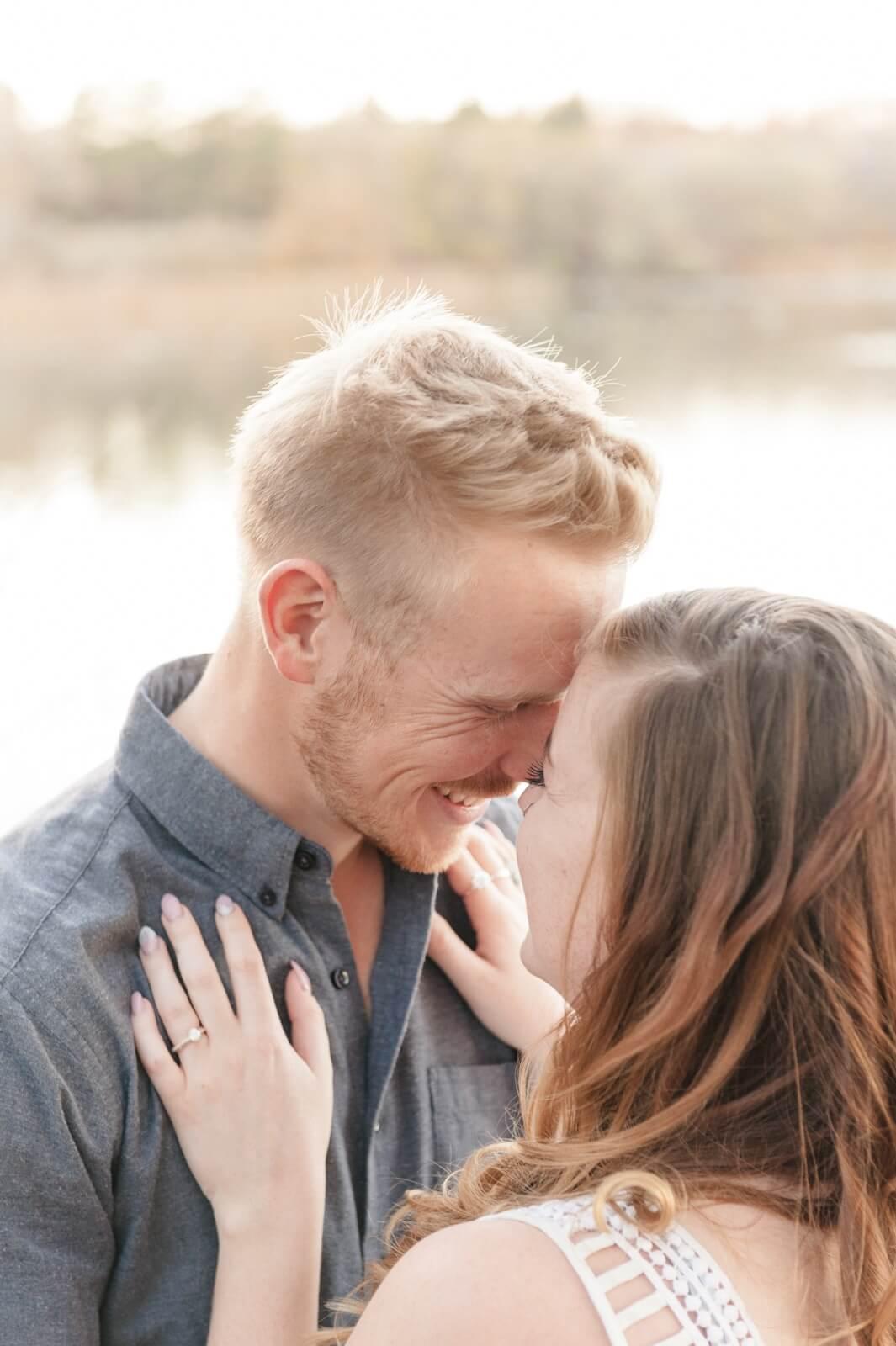 Regina Engagement Photographer - Evan-Chantel - Laughing by the lake