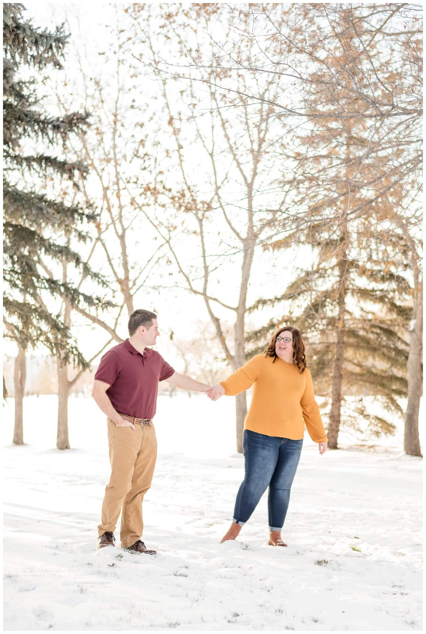 Regina Family Photographer - Goudy Family - Winter Family Session - Snow - Mustard Sweater with Blue Jeans - Candy Cane Park