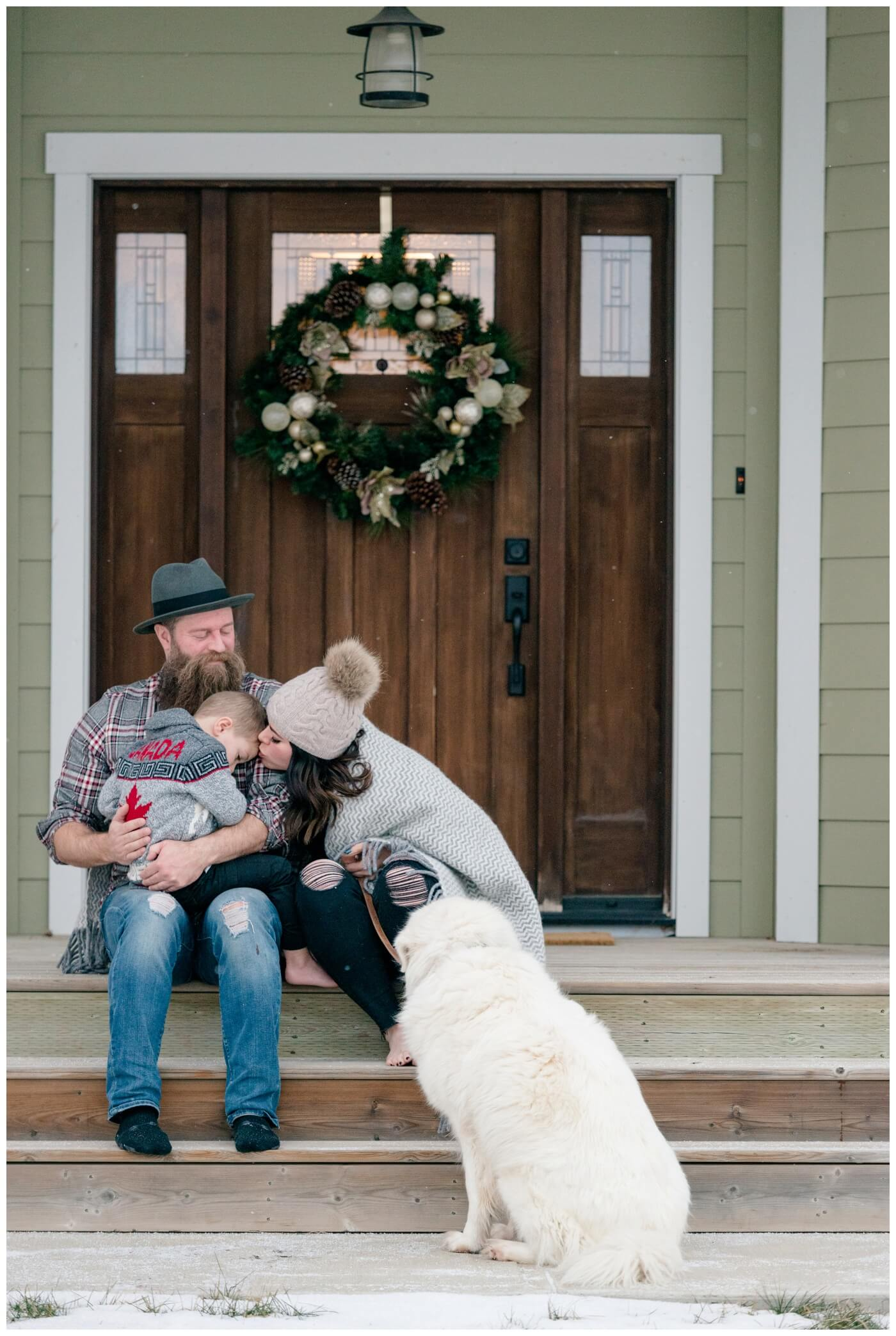 Regina Family Photographer - Keen Family - Dionne-Timothy-Shepherd - In home Family Session - Front Porch Snuggle - Blanket - Barefeet - Pompom Toque