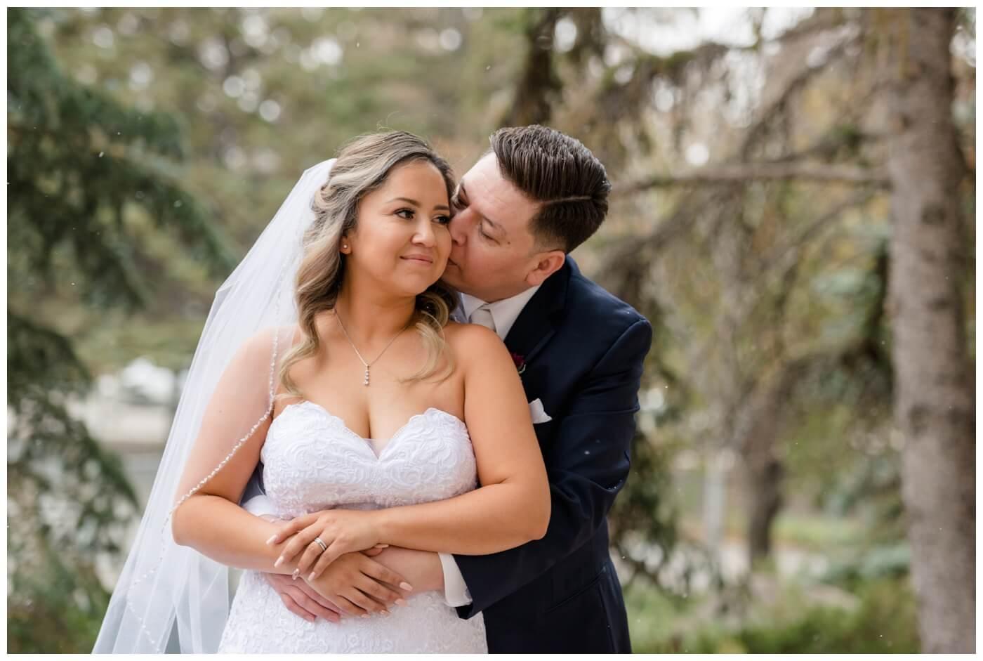 Regina Wedding Photographer - Laurie - Destiny - Fall Wedding - TC Douglas Building - Pine Trees - Falling Snow