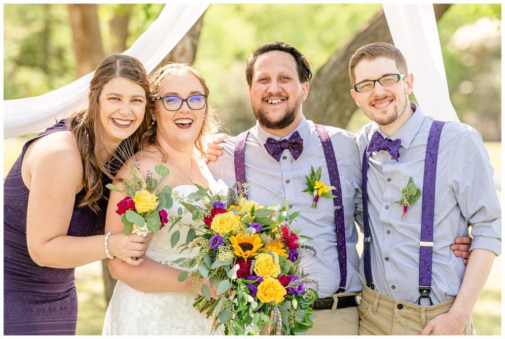 Regina Wedding Photographer - Ryan - Aeliesha - Bridal Party pose together - Bridesmaids purple lace dress - AE Wilson Park