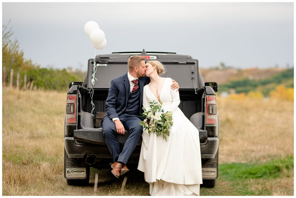 Regina Wedding Photographers - Tyrel - Allison - Groom & Bride in the back of a truck