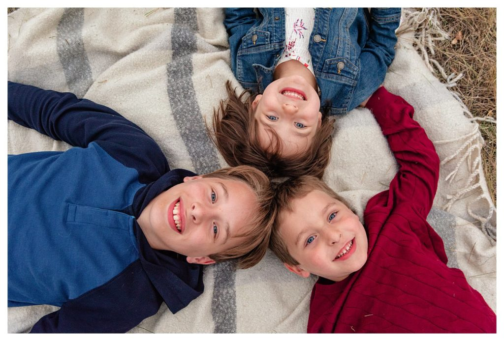 Schlamp Family 2020 - 009 - Regina Family Photographer - Kids laying with heads together