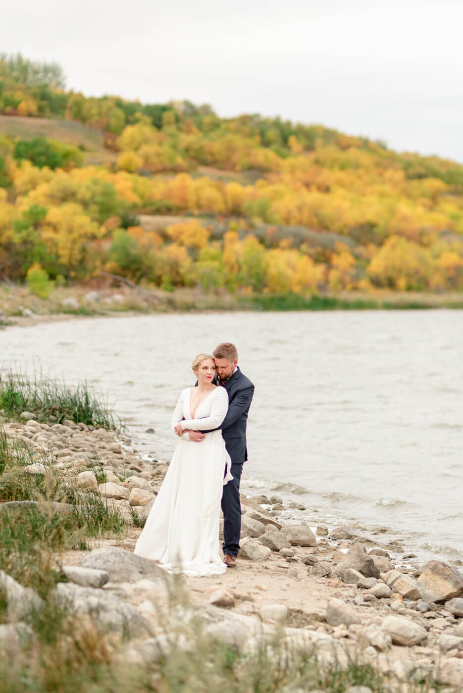 Tyrel & Allison - Bride & Groom by river in Qu'appelle Valley Lumsden