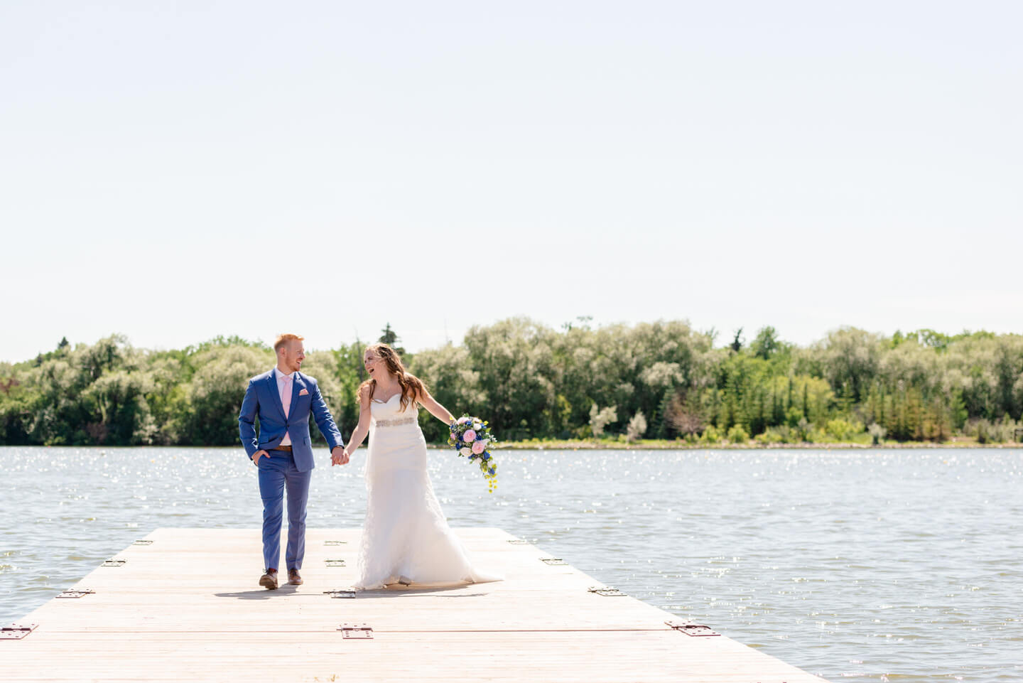Bride & Groom at boat launch on Wascana Lake after wedding