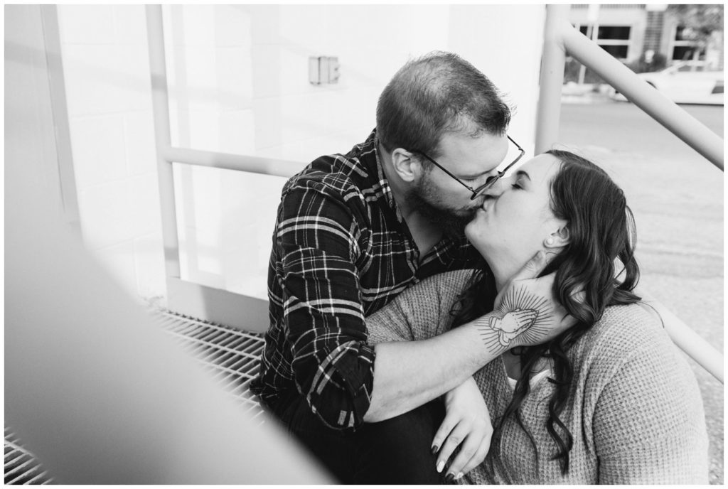 Regina-Engagement-Photographer-Kolton-Maxine-002-Couple-kissing-on-steps