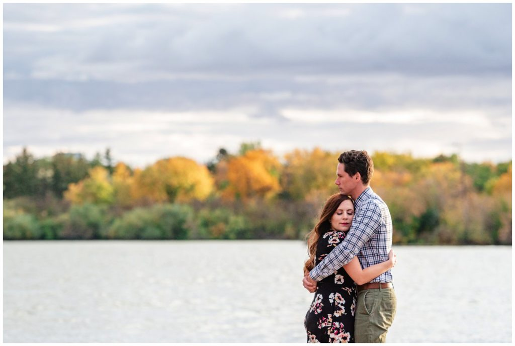 Regina-Engagement-Photography-007-Tim-Jennelle-Standing-on-the-docks-on-Wascana-lake
