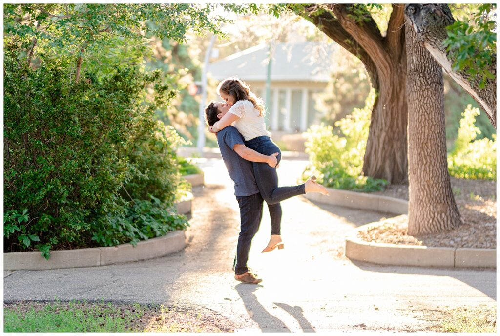 Regina Engagement Photography - Adam - Sarah - Natural Light Engagement Session in Wascana Park - Couple kisses in the evening light