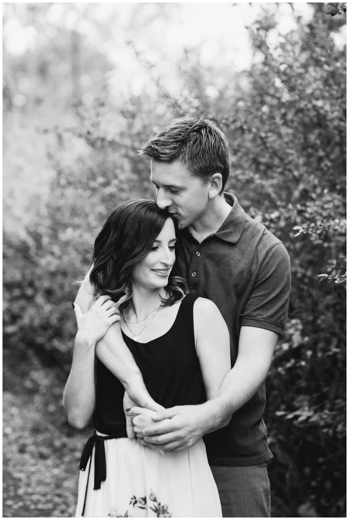 Regina Engagement Photography - Taylor & Jolene - 002 - White City Engagement Session - Black and white kissing forehead