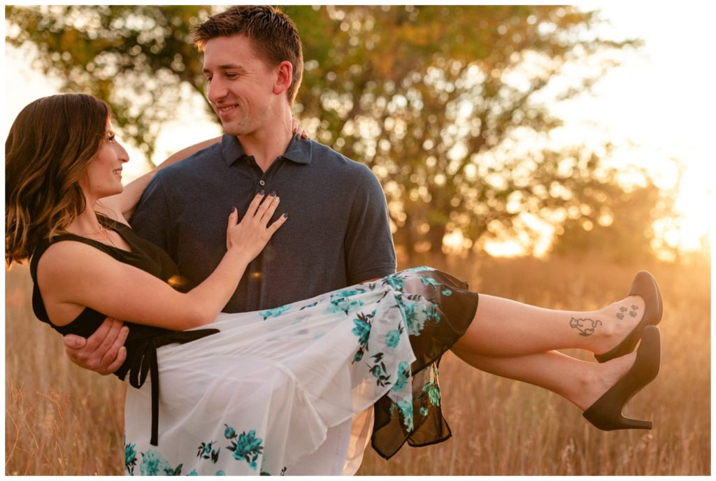 Regina-Engagement-Photography-Taylor-Jolene-006-White-City-Engagement-Session-Carrying-fiancee