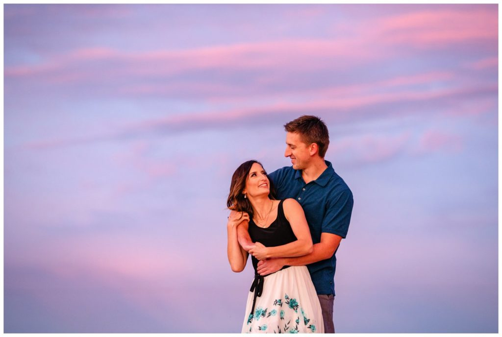 Regina-Engagement-Photography-Taylor-Jolene-010-White-City-Engagement-Session-Couple-in-front-of-beautiful-purple-sunset-sky