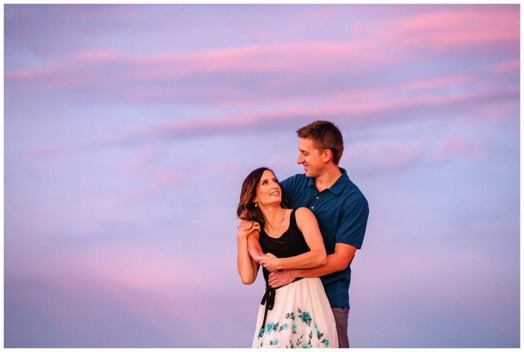 Regina-Engagement-Photography-Taylor-Jolene-010-White-City-Engagement-Session-Couple-in-front-of-beautiful-purple-sunset-sky