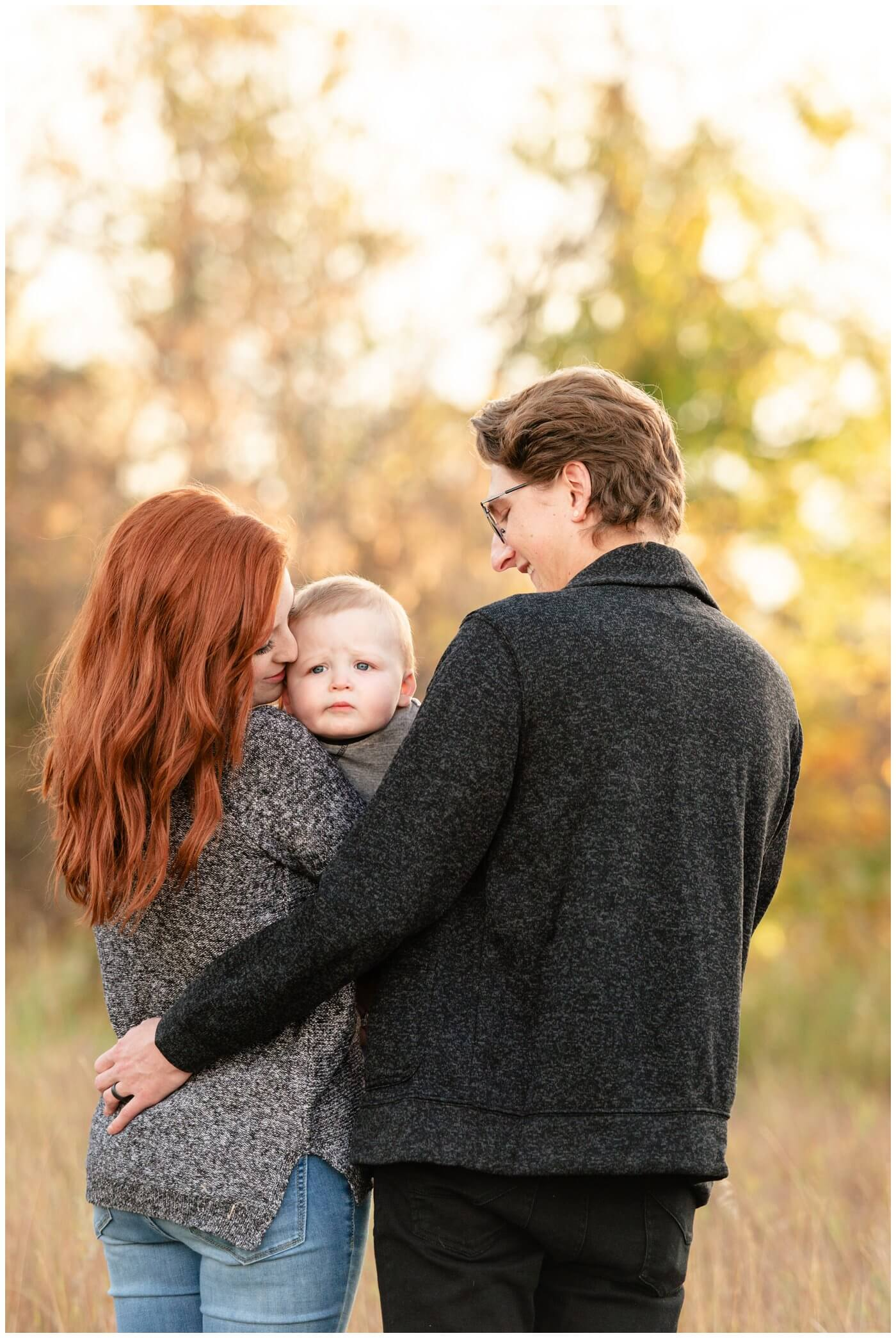 Regina-Family-Photography-McFie-family-006-Child-not-interested-in-photos-