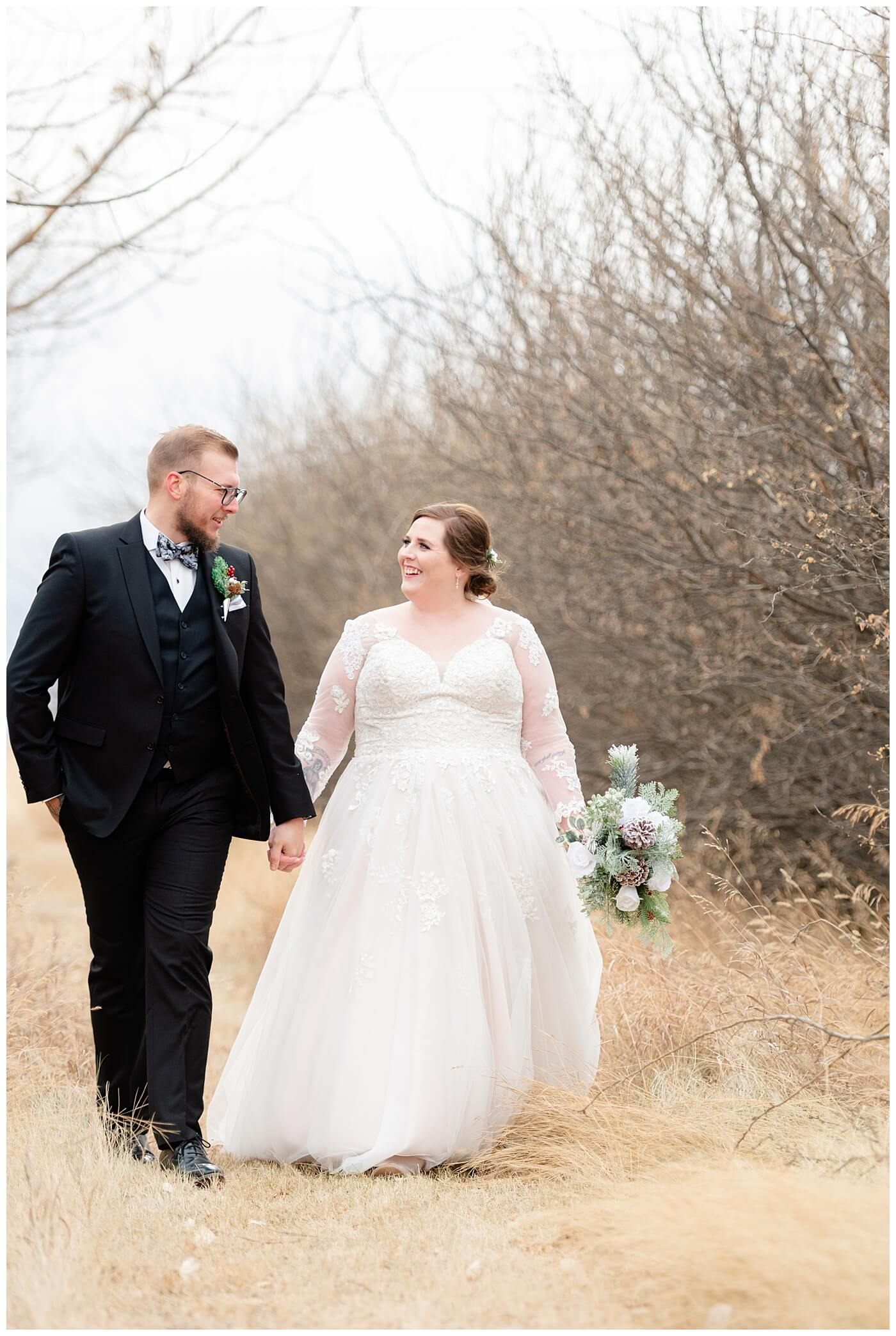 Regina Wedding Photographer - Kolton - Maxine - Bride & Groom walk through tall grass
