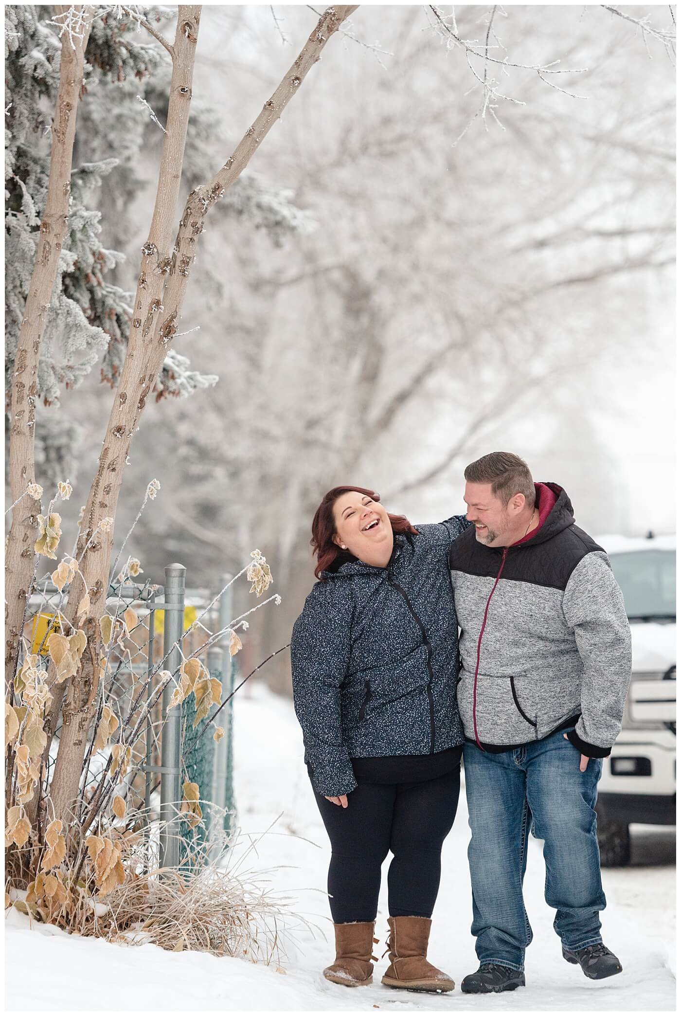 Regina Wedding Photographers - Ashley - Scott - Couple walks down the street together in the snow