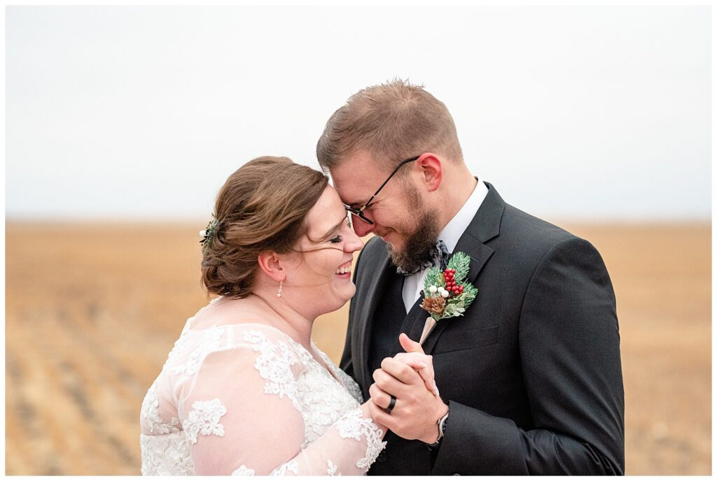Regina Wedding Photography - Kolton - Maxine - Bride & Groom pull in close for their first dance