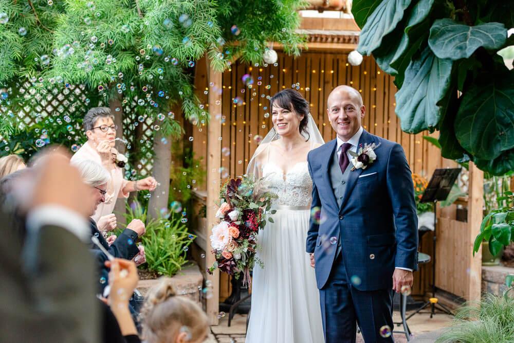 Scott & Kelly - Wedding Bubble Exit - Indoor Locations - Regina Floral Conservatory