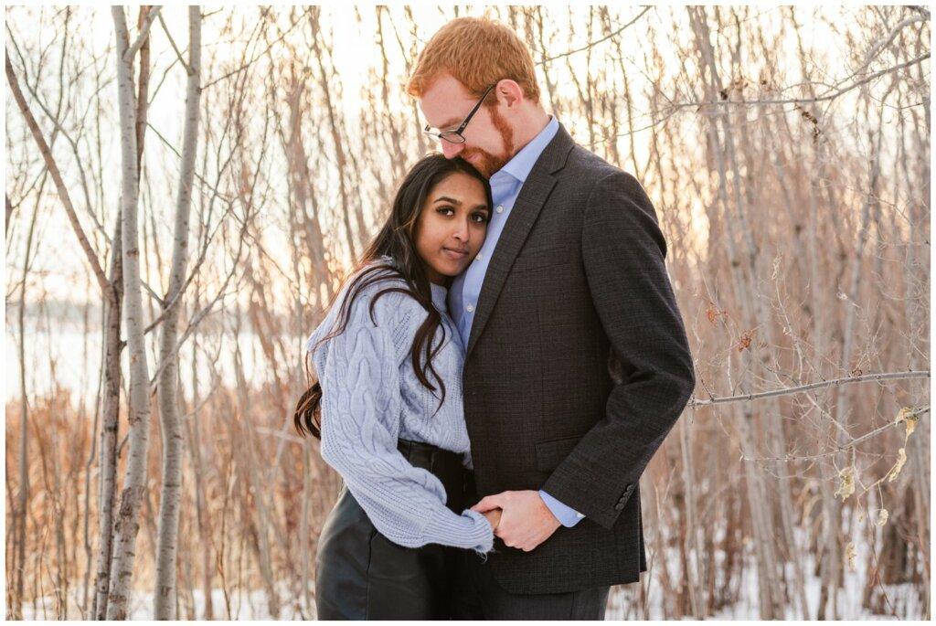 Regina Engagement Photography - Stephen & Sarah - 007 - Sarah Looking at camera in woods