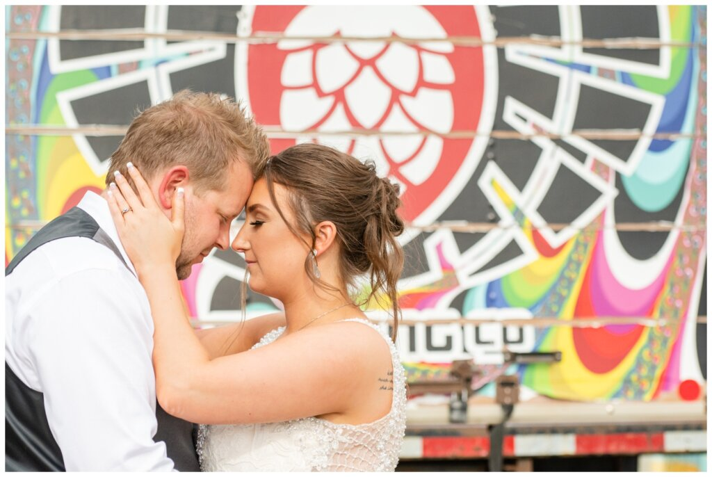 Jon & Callie - 21 - Bride and Groom Outside of Rebellion Brewing Company