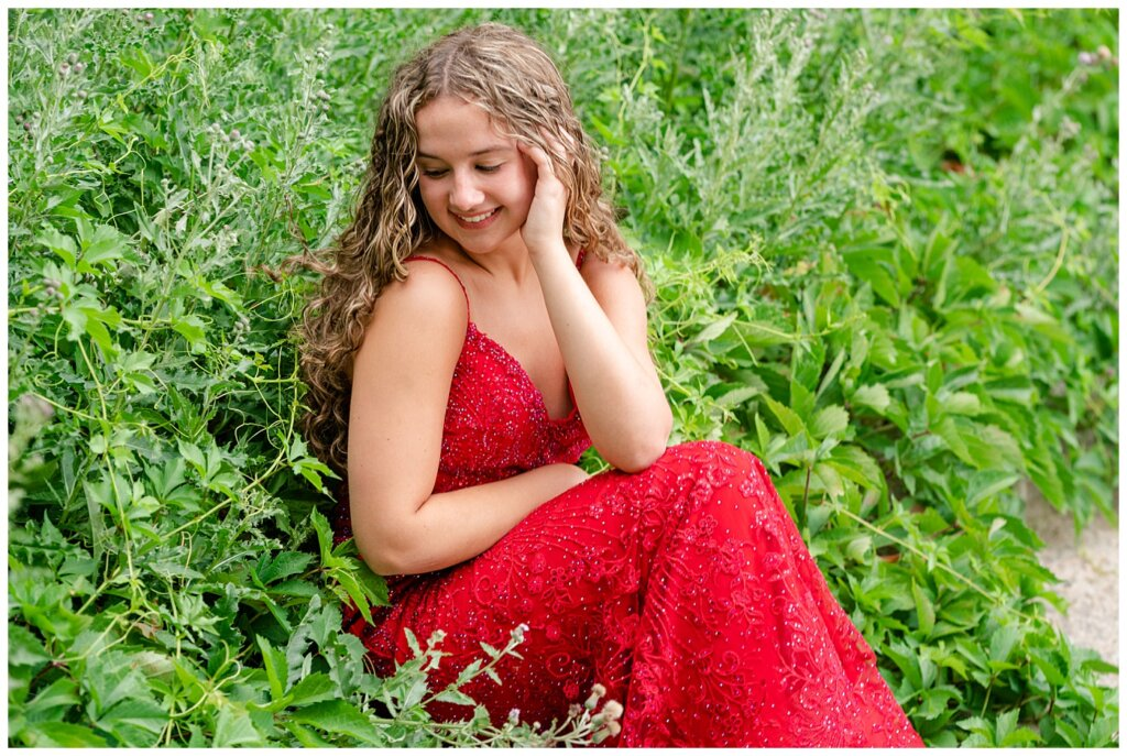 Cailey Baseden - Graduation 2021 - 08 - High school senior sitting among the weeds