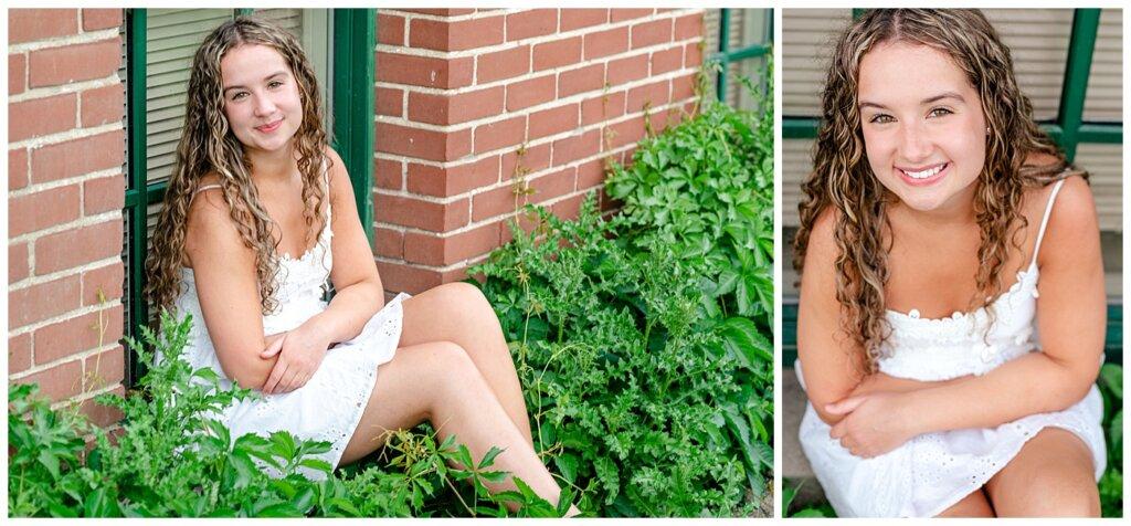 Cailey Baseden - Graduation 2021 - 13 - High school grad in white dress sitting on green window frame